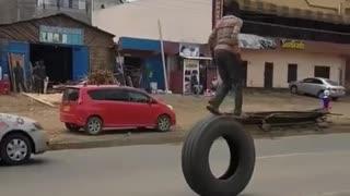 little boy fun riding on big tyre