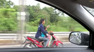 Woman Texts While Driving Scooter