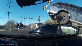 Red Light Runner Lifts Truck Onto Traffic