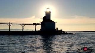 Stunning winter drone footage of Lake Michigan lighthouse