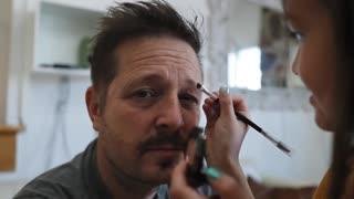 Doing my dad's makeup.