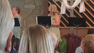 Mindy singing in church