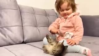 First Time Cute Baby Meets New Kitten