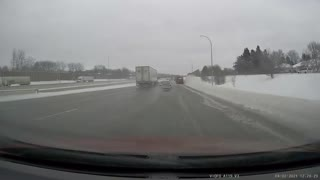 Car Spins out on Slick Roads and Dodges all Traffic