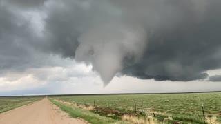 Storm Chaser Walks Towards Tornado