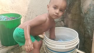 Kid is playing with wet clothes