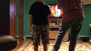Spencer playing fruit ninja with dad VID_20181010_171650