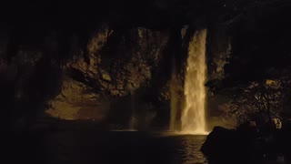 Waterfall at night with light