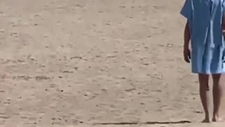 Man In Hospital Gown Stumbles Through Toronto's Woodbine Beach