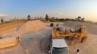 Workers unloading gravel