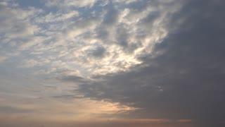 Red sun hidden by clouds