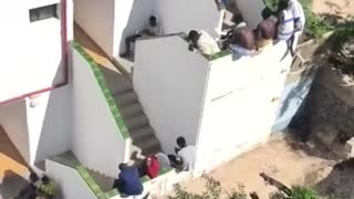 Migrants Party in Taxpayer-Funded Resort Pool while Spain Remains in Lockdown