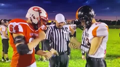 Football team decides coin toss with game of rock, paper, scissors.