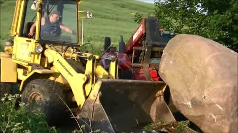 pulling stone 14 tons! Massey Ferguson tractor and New Holland loader