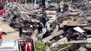 Florida rescue crews tackle collapsed building debris