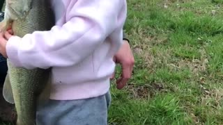 Girl Hugging Fish