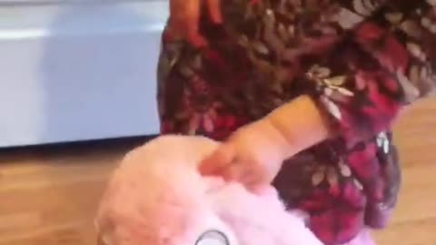 Emma and bunny clap hands