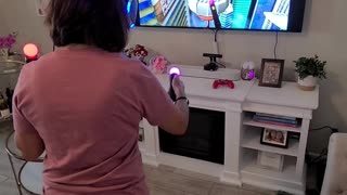 Woman Struggles Playing VR Game