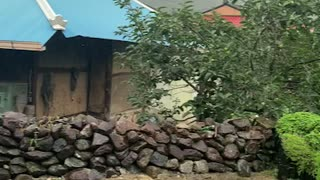 traditional house and wall in countryside of korea, rain dropped sliding from the roof