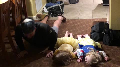 """Little girls hilariously attempt to do """"the worm"""" dance move"""
