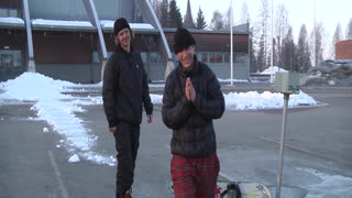 Snowboarder Turns Roof into Rail