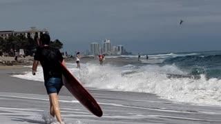 Surfers at Palm Beach