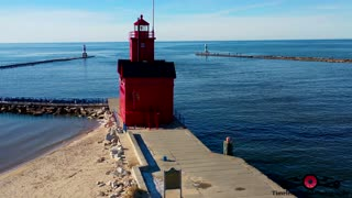 Stunning winter drone footage of Holland Harbor Lighthouse in Michigan