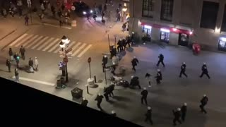 Video Shows A Woman Being Pushed To The Ground By SWAT At Last Week's Anti-Curfew Protest