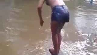 young girls jumping in the river