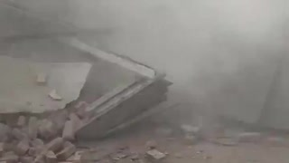 Witness nearly crushed to death by collapsing building