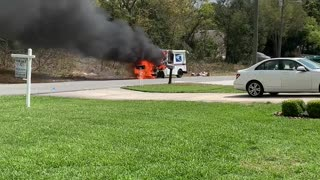 Firefighters Put out Mail Truck Engulfed in Flames