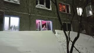 Moment Kids Slide Down Snow Drift From 1st-Floor Window