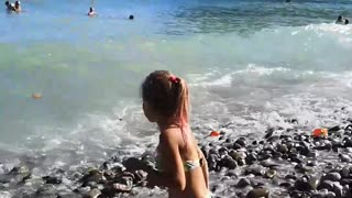 Little girl catches waves