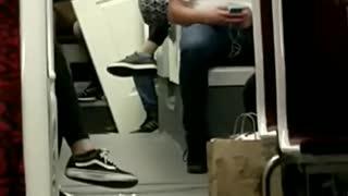Guy brings white door onto subway train