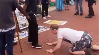 White Man Kisses Black Israelites' Shoes To Apologize For Slavery