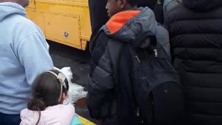 Children Being Held on Bus