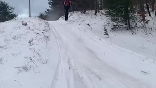 Slow Motion Snowmobile Wipeout