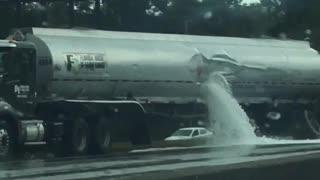 Fuel Tanker Spills its Load onto Highway