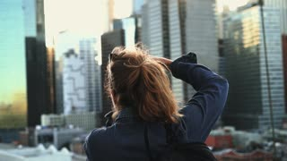Woman Taking Pictures of the City