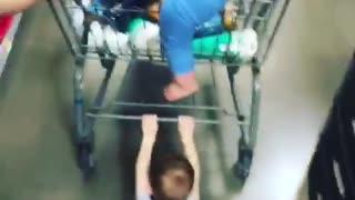Kid holding onto shopping cart dragged across floor