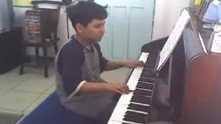 Pre-teen Nico practicing piano (Part 2)