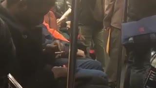 Man subway asleep blunt cigarette in hand
