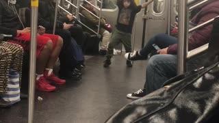 Little boy dances on subway train, hip hop song