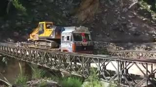 Bridge collapses under weight of moving truck near Indo-China border