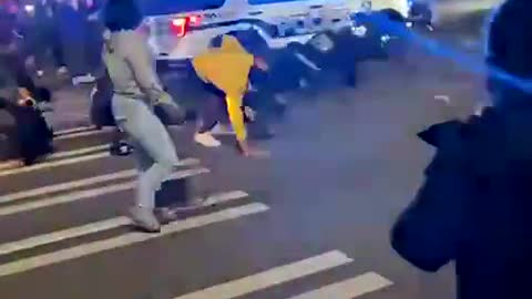 Tacoma Police Vehicle Driving Over Crowded People In The Street