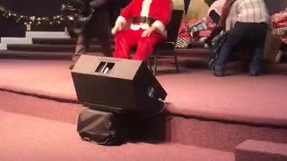 Santa Takes a Tumble on the Stage