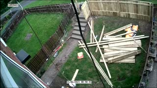 Guy Tearing Down Fence Takes a Tumble
