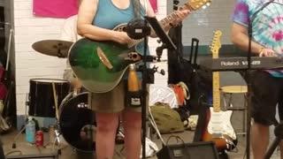 Family band subway performance guitar music