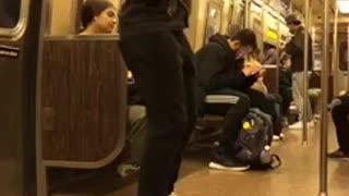 Man rapping on subway train