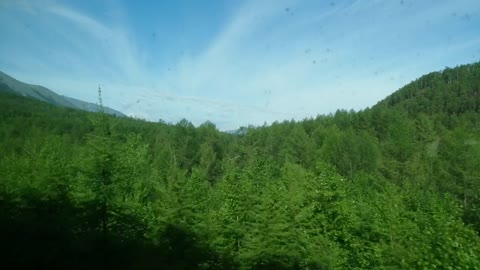 We go by train and see a beautiful landscape.